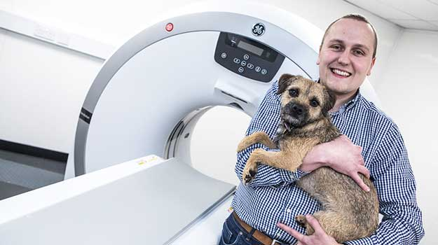 Mark Turnbull and Willow with the new CT scanner.