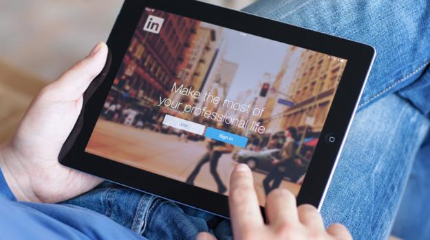 Man accessing LinkedIn on iPad