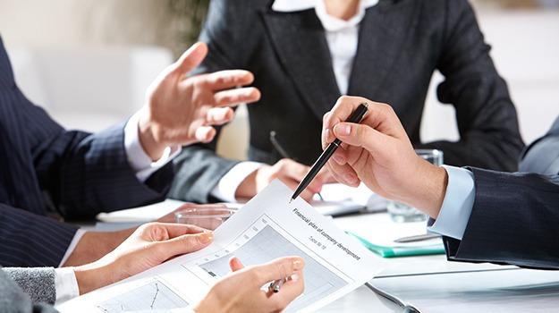 close-up of businessman explaining a financial pla