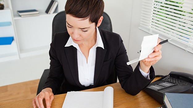 accountant checking receipts in her office