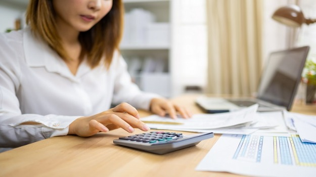 female recruiter using calculator