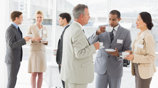 Business people chatting and drinking coffee at a