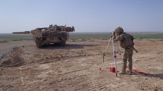 Ian Webster surveying in the army